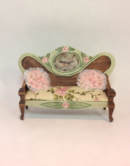 sofa with roses and bird